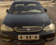 Автомобиль  KIA CLARUS, черный